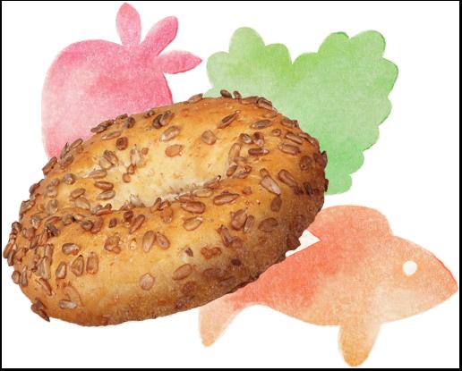 Kokonainen bagel, jonka ympärillä on mansikan, salaatin ja kalan muotoiset koristeet
